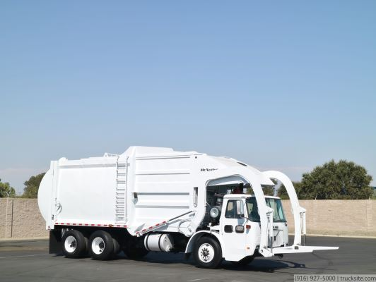 2001 Volvo Low Entry McNeilus 40 Yard Front Load Garbage Truck